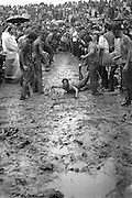 Woodstock Rock Festival fans sliding down a muddy hill at the Woodstock rock festival at Max Yasgur's 600 acre farm, in the rural town of Bethel, NY, on the weekend of August 16-18, 1969.