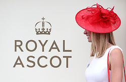 A female racegoer in a hat during day two of Royal Ascot at Ascot Racecourse.