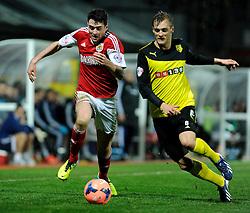 Bristol City's Brendan Moloney and Watford's Joel Ekstrand runs for the ball - Photo mandatory by-line: Dougie Allward/JMP - Tel: Mobile: 07966 386802 14/01/2014 - SPORT - FOOTBALL - Vicarage Road - Watford - Watford v Bristol City - FA Cup - Third Round - replay