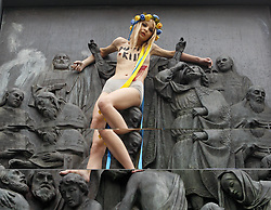 July 27, 2017 - Kiev, Ukraine - An activist of the women feminist movement 'FEMEN' protests on the monumetn of the St. Vladimir Statue, on St. Vladimir's Hill in center Kiev, Ukraine, on 27 July, 2017. FEMEN protest against a religion procession organized by the Ukrainian Orthodox Church of the Moscow Patriarchate in Ukraine, during celebration the 1029th anniversary of Kievan Rus Christianization in Kiev. (Credit Image: © Serg Glovny via ZUMA Wire)