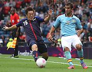 Men's Olympic Football match Spain v Japan on 26.7.12...Manabu Saito of Japan and Martin Montoya of Spain, during the Spain v Japan Men's Olympic Football match at Hampden Park, Glasgow...Picture John Millar / ProLens PhotoAgency / PLPA.Thursday 26th July 2012......................
