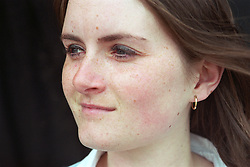 Portrait of homeless teenage girl smiling,