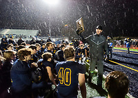 Oak Ridge Trojans head coach Eric Cavaliere, holds up the runner up plaque after losing to the Central High School Grizzlies in the Div I NorCal football championship game Friday, December 6, 2019.