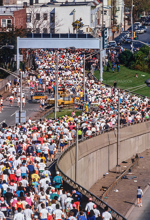 NEW YORK - NOVEMBER 3:  Runners competing in the 1991 New York City Marathon exit from the Verrazzano Bridge into to Brooklyn near the beginning of the race on November 3, 1991 in New York, New York.  (Photo by David Madison/Getty Images)