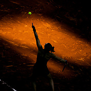 PARIS, FRANCE June 10. Maria Sakkari of Greece in serving against Barbora Krejcikova of the Czech Republic as the early evening shadows creep across Court Philippe-Chatrier during the semi finals of the Women's singles competition at the 2021 French Open Tennis Tournament at Roland Garros on June 10th 2021 in Paris, France. (Photo by Tim Clayton/Corbis via Getty Images)