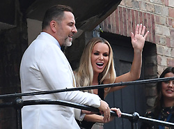 David Walliams and Amanda Holden wave to fans from a balcony at the Hammersmith Apollo, London, ahead of the final of Britain's Got Talent.