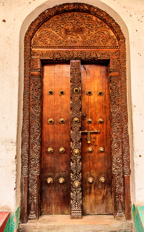A carved door in Mombasa, Kenya. Some houses have intricately carved wooden doors, a symbol of status for the merchant residents who commissioned them.