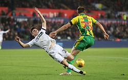 Swansea City's Daniel James and West Bromwich Albion's Craig Dawson