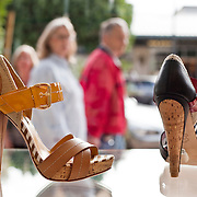 High-end designer shoes in a window stop shoppers as they stroll through Kierland Commons Main Street shopping experience, located in Scottsdale, AZ.