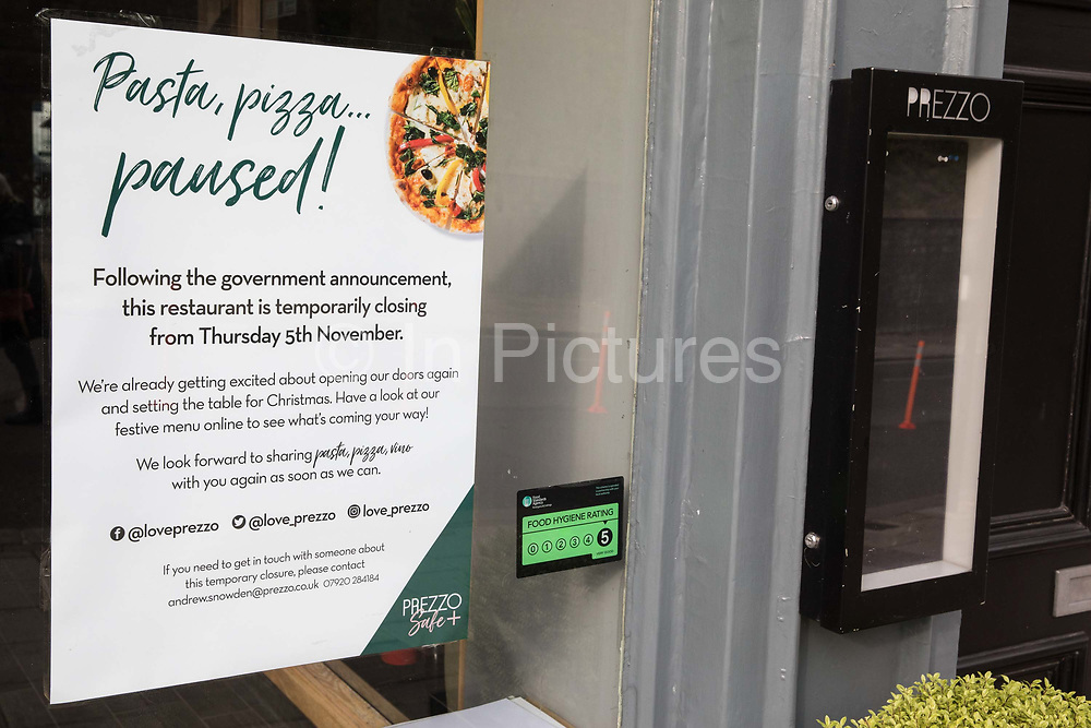 """A notice indicates that a branch of pasta and pizza chain Prezzo is closed on the second day of England's second coronavirus lockdown on 6 November 2020 in Windsor, United Kingdom. Only retailers selling """"essential"""" goods and services are permitted to open to the public during the second lockdown and cafes, restaurants and pubs must remain closed unless they are providing food and drink for takeaway before 10pm, click-and-collect, drive-through or delivery."""