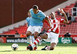 Stoke City's Steven N'Zonzi tackles Manchester City's Jack Rodwell - Photo mandatory by-line: Matt Bunn/JMP - Tel: Mobile: 07966 386802 14/09/2013 - SPORT - FOOTBALL -  Britannia Stadium - Stoke-On-Trent - Stoke City V Manchester City - Barclays Premier League