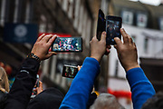Multiple mobile phones being used as cameras during the Chinese New Year celebrations, 26th January 2020, Chinatown, Soho, London, United Kingdom. Londons Lunar New Year festivities welcome the Year of the Rat.