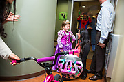 Dr. Rabitz Pediatric Dentistry give away a bike to one of their patients at Dr. Rabitz Pediatric Dentistry in San Jose, California, on October 31, 2017. (Scott MacDonald for Stan Olszewski/SOSKIphoto)