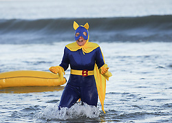© Licensed to London News Pictures. 26/12/2013<br /> <br /> Saltburn, Cleveland, United Kingdom<br /> <br /> Hundreds of swimmers brave the elements in fancy dress to take part in the annual Boxing Day dip on the beach in Saltburn, Cleveland to help raise money for a number of different charities.<br /> <br /> Photo credit : Ian Forsyth/LNP