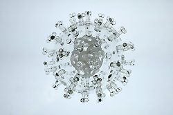 """IN PHOTO: COVID-19 coronavirus<br /> <br /> Internationally-renowned British artist Luke Jerram has created a coronavirus glass sculpture in tribute to the huge global scientific and medical effort to combat the pandemic.<br /> <br /> Made in glass, at 23cm in diameter, it is 1 million times larger than the actual virus. <br /> <br /> It was commissioned 5 weeks ago by a university in America to reflect its current and future research and learning in health, the environment and intelligent systems, and its focus on solving global challenges.  <br /> <br /> Luke says: """"Helping to communicate the form of the virus to the public, the artwork has been created as an alternative representation to the artificially coloured imagery received through the media. In fact, viruses have no colour as they are smaller than the wavelength of light."""" <br /> <br /> """"This artwork is a tribute to the scientists and medical teams who are working collaboratively across the world to try to slow the spread of the virus. It is vital we attempt to slow the spread of coronavirus by working together globally, so our health services can manage this pandemic."""" <br /> <br /> Made through a process of scientific glassblowing, the coronavirus model is based on the latest scientific understanding and diagrams of the virus.  <br /> <br /> Profits from this glass model are going to Médecins Sans Frontières (MSF) who will be assisting developing countries deal with the fallout of the coronavirus epidemic. <br /> <br /> This new model is just the latest in Luke's Glass Microbiology series of virus sculptures. Luke and his glassblowing team have, in the past, made other sculptures of viruses from swine flu and Ebola to smallpox and HIV.<br /> <br /> Respected in the scientific community, the glass sculptures have featured inThe Lancet,Scientific American,British Medical Journal (BMJ)and on the front cover ofNature Magazine.  <br /> <br /> TheGlass Microbiologysculptures are in museum collections around th"""