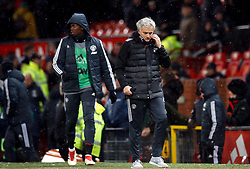 Manchester United manager Jose Mourinho and Paul Pogba (background) after the Emirates FA Cup, quarter final match at Old Trafford, Manchester.