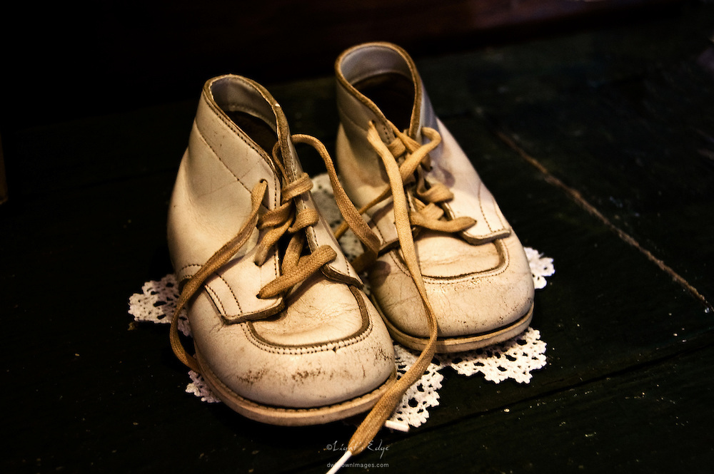 A pair of baby shoes sitting in an antiques store reminds of how fast time goes. Enjoy them everyday for they will be gone before you know it.