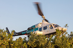 Medical Rescue Helicopter Airlifting Patient At Papua Gulch