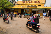 02 APRIL 2012 - HANOI, VIETNAM: Commuters ride past the Long Bien Train Station in Hanoi, the capital of Vietnam.    PHOTO BY JACK KURTZ