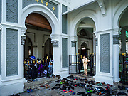 "22 AUGUST 2018 - GEORGE TOWN, PENANG, MALAYSIA:  A child leaves Kapitan Keling Mosque after services for Eid al-Adha services. It is the oldest mosque in George Town. Eid al-Adha, ""Feast of the Sacrifice"" is the second of two Islamic holidays celebrated worldwide each year. It honors the willingness of Ibrahim (Abraham) to sacrifice his son as an act of obedience to God's command.    PHOTO BY JACK KURTZ"