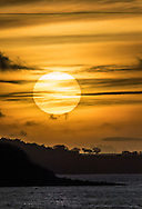 The sun setting over The Solent, Isle of Wight, photographed from a few miles away at Gurnard.