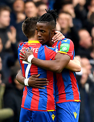 Crystal Palace's Wilfried Zaha (right) celebrates scoring his side's first goal of the game with teammate Yohan Cabaye during the Premier League match at Selhurst Park, London.
