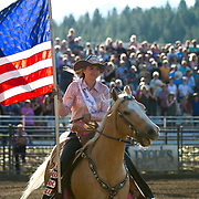 The Darby Rodeo Queen presents the Stars and stripes at the Darby MT Elite Proffesionals Bull Riding Event July 7th 2017.  Photo by Josh Homer/Burning Ember Photography.  Photo credit must be given on all uses.