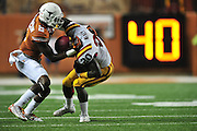 AUSTIN, TX - OCTOBER 18:  DeVondrick Nealy #20 of the Iowa State Cyclones is brought down by Mykkele Thompson #2 of the Texas Longhorns on October 18, 2014 at Darrell K Royal-Texas Memorial Stadium in Austin, Texas.  (Photo by Cooper Neill/Getty Images) *** Local Caption *** Mykkele Thompson; DeVondrick Nealy