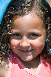 Portrait of a little girl smiling,