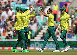 South Africa's Imran Tahir (second right) celebrates after taking the wicket of Bangladesh's Shakib Al Hasan during the ICC Cricket World Cup group stage match at The Oval, London.