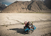 A side car on the road near Langar village.<br /> In the Wakhan Corridor, Tajikistan side, in the Pamir mountains. Afghanistan is on the other side of the Panj river.<br /> <br /> Tajikistan, a mountainous landlocked country in Central Asia. Afghanistan borders it to the south, Uzbekistan to the west, Kyrgyzstan to the north, and People's Republic of China to the east. Tajikistan also lies adjacent to Pakistan separated by the narrow Wakhan Corridor.<br /> Tajikistan became a republic of the Soviet Union in the 20th century, known as the Tajik Soviet Socialist Republic.<br /> It was the first of the Central Asian republic to gain independence in December 1991.