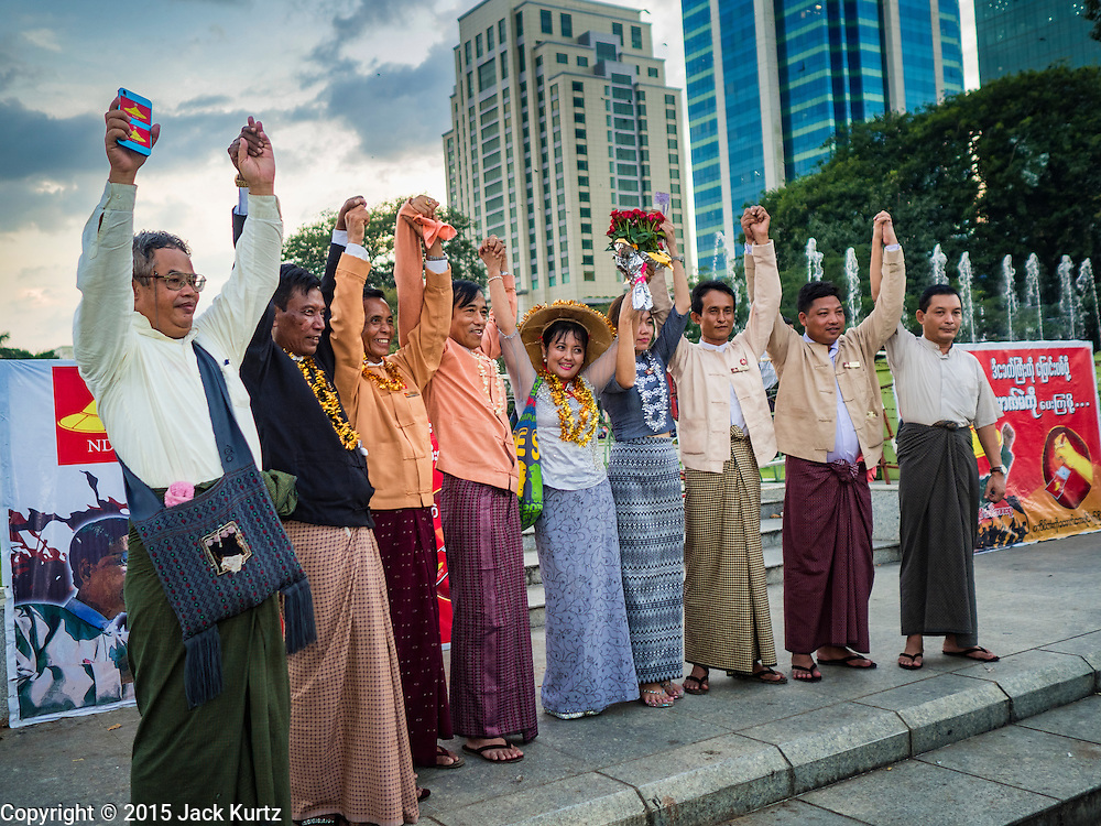 06 NOVEMBER 2015 - YANGON, MYANMAR:  NDF officials clasp hands at the end of the final NDF election rally of the 2015 election. The rally was held in central Yangon, next to the historic Sule Pagoda and across the street from Yangon city hall. The National Democratic Force (NDF) was formed by former members of the National League for Democracy (NLD) who chose to contest the 2010 general election in Myanmar because the NLD boycotted that election. There have been mass defections from the NFD this year because many of the people who joined the NFD in 2010 have gone back to the NLD, which is contesting this year's election and widely expected to win it. Campaigning in the Myanmar election ended Friday. People go to the polls Sunday.    PHOTO BY JACK KURTZ