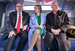 © Licensed to London News Pictures. 12/11/2018. Bristol, UK. Left-right, sitting on a hybrid electric bus laid on specially to take them from Bristol Temple Meads train station to Bristol City Hall: GRAHAME MORRIS MP House of Commons Transport Committee, LILIAN GREENWOOD MP chair of the House of Commons Transport Committee, DANIEL ZEICHNER MP House of Commons Transport Committee. Members of the House of Commons' Transport Committee visit Bristol to hear about bus services in the area. The Chair of the Transport Committee, Lilian Greenwood, is joined by committee members Grahame Morris and Daniel Zeichner, and will meet with Bristol City Council and First Group who run the large majority of Bristol buses, followed by Mayor of Bristol, Marvin Rees. In the first public evidence session the Committee has held outside Westminster, the Committee will then take evidence from the West of England Metro Mayor and representatives from Plymouth City Council and Devon County Council. MPs want to hear the views of local authorities about how the market works, what can be done to improve bus services and how they would like to see the future of bus services developing. The main issues surrounding the use of new powers given to local authorities by the Bus Services Act 2017 will also be under consideration. Buses account for five percent of all journeys in the UK. In Bristol buses are the most popular form of public transport, and the number of passenger journeys in Bristol has risen by more than 40% since 2009/10 compared to bus travel in English metropolitan areas outside London, which has declined by 40% over the last 25 years. Bristol City Council has recently concluded a consultation into their Transport Strategy up to 2036. Photo credit: Simon Chapman/LNP