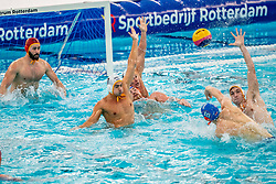Pascal Janssen, Jorn Winkelhorst of the Netherlands in action against Slaven Kandic, Stefan Vidovic, Marko Petkovic of Montenegro during the Olympic qualifying tournament. The Dutch water polo players are on the hunt for a starting ticket for the Olympic Games on February 19, 2021 in Rotterdam
