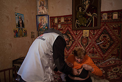 Lydia Momarova, 80, suffers from chronic hypertension and is unable to walk far from her home. Her small apartment still bears the broken windows and scars of the fierce batlles that were fought in the city in February and she suffers terribly from the cold. A home visit team from MSF visited Lydia, 20 April to check on her health and to deliver much needed medicines that are unavailable in the town.