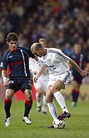 29/2/2004 Madrid, Spain.<br />La Liga (Spanish League) 26 day.<br />R.Madrid 4 - Celta 2<br />R.Madrid's Zidane in duel with Celta's Edu at Santiago Bernabeu's Stadium.