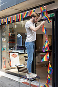 Rainbow flags of the Pride movement being hung outside a shop in Soho, London, United Kingdom. The rainbow flag, commonly the gay pride flag and sometimes the LGBT pride flag, is a symbol of lesbian, gay, bisexual, and transgender LGBT pride and LGBT social movements. It has been in use since the 1970s.