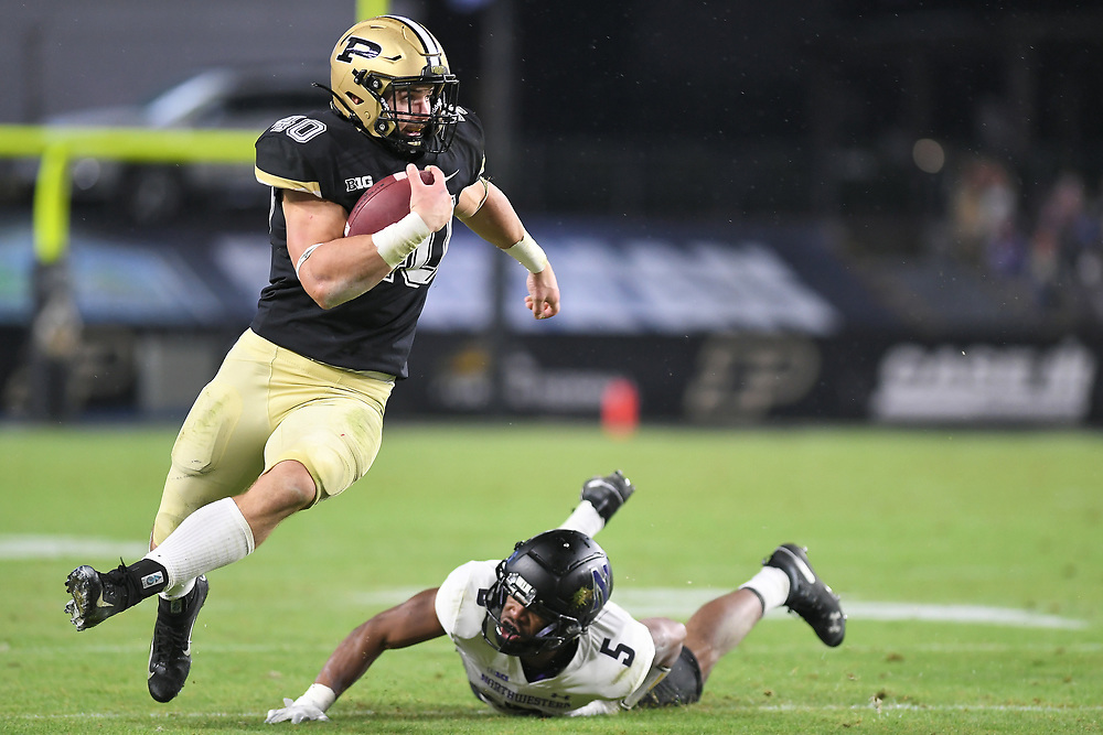 November 14, 2020:  Purdue running back Zander Horvath (40) rums with the ball as Northwestern defensive back JR Pace (5) makes diving attempt at the tackle during NCAA football game action between the Northwestern Wildcats and the Purdue Boilermakers at Ross-Ade Stadium in West Lafayette, Indiana. Northwestern defeated Purdue 27-20.  John Mersits/CSM.
