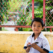 Schoolboy playing with electronic toy