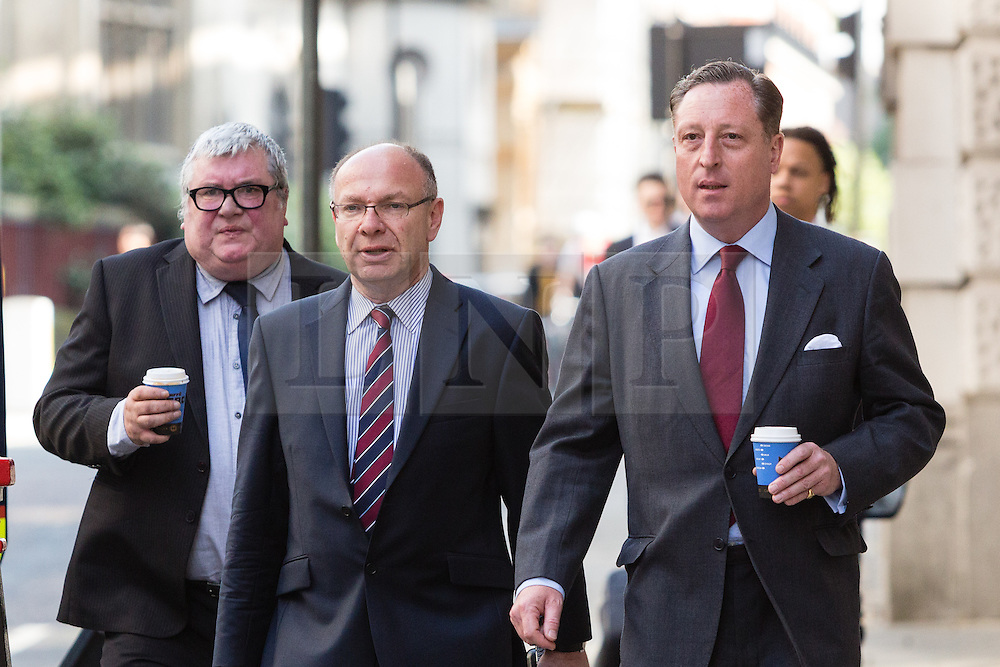 © Licensed to London News Pictures. 30/06/2014. London, UK. Greg Miskiw (left) and Neville Thurlbeck (right) arrives at The Old Bailey in central London this morning, 29th June 2014.. Photo credit : Vickie Flores/LNP