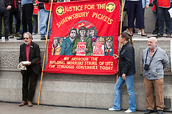 London, UK. 1st May, 2019. Supporters of the Shrewsbury 24 join representatives of trade unions and socialist and communist parties from many different countries at the annual May Day rally in Trafalgar Square to mark International Workers' Day.