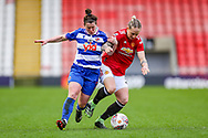 Reading defender Emma Mitchel (3) and Manchester United midfielder Leah Galton (11) tussle for the ball during the FA Women's Super League match between Manchester United Women and Reading LFC at Leigh Sports Village, Leigh, United Kingdom on 7 February 2021.