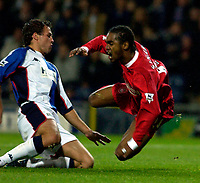 Photo. Jed Wee.<br /> Blackburn Rovers v Liverpool, Carling Cup, Ewood Park, Blackburn. 29/10/03.<br /> Liverpool's Florent Sinama-Pongolle (R) goes flying as Blackburn's Lucas Neill sends him sprawling in the penalty area.