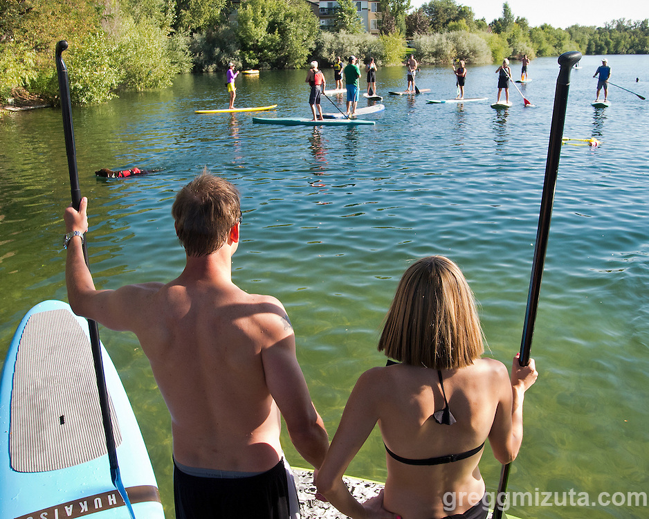 Holt Haga and Katie Mooney at Western Capital Bank's first annual SUP & SIP event at Quinn's Pond and Idaho River Sports in Boise, Idaho on September 5, 2012.