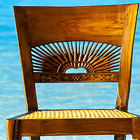 Punta Cana Resort, Dominican Republic.  Water, light and texture of a hand carved wooden chair captured my attention.