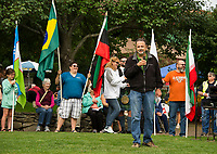 Mayor Ed Engler welcomes the crowd gathered at Rotary Park for the annual Multicultural Festival on Saturday following the Parade of Flags.  (Karen Bobotas/for the Laconia Daily Sun)
