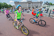 The riders pass Buckingham Palace - Prudential RideLondon a festival of cycling, with more than 95,000 cyclists, including some of the world's top professionals, participating in five separate events over the weekend of 1-2 August.