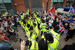 "© Licensed to London News Pictures . 22/08/2015 . Manchester , UK . Police separate anti-fascists and far right protesters . Far-right nationalist group , "" North West Infidels "" and Islamophobic , anti-Semitic and white supremacist supporters , hold a rally in Manchester City Centre . Photo credit : Joel Goodman/LNP"