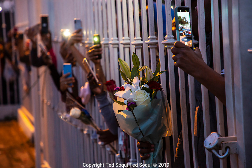 A memorial held at the Staples Center Arena and 25 mile long funeral procession held for slain rapper Nipsey Hussle in Los Angeles.<br /> Fans with flowers near the funeral hoe where Nipsey Hussle's casket is.<br /> 3/11/2019 Los Angeles, CA USA <br /> (Photo by Ted Soqui/SIPA)