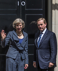 Downing Street, London July 26th 2016. Irish Taoiseach Enda Kenny is the first foreign leader to arrive in Downing Street since Theresa May became Prime Minister is welcomed by Mrs May for talks centred around economic and border issues arising from Brexit. <br /> ©Paul Davey<br /> FOR LICENCING CONTACT: Paul Davey +44 (0) 7966 016 296 paul@pauldaveycreative.co.uk